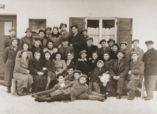 Group portrait of former Bielski partisans from Nowogrodek...