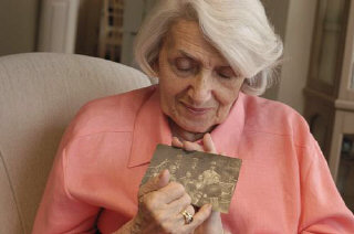 Blanka Rothschild holds one of her prewar family ph...