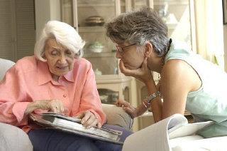 Blanka Rothschild and Neenah Ellis look through Blanka's...
