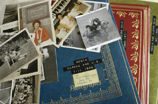 Stack of Regina Gelb's photographs and albums.