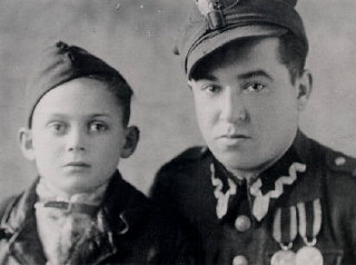 Thomas (left), 6 months after liberation, with a soldier...