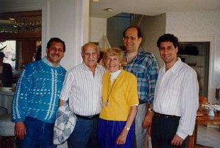 Lisa and Aron (center) with their three sons, Gordon...