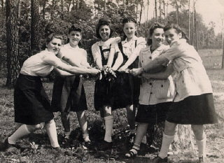 Regina (third from left) with friends while at the...
