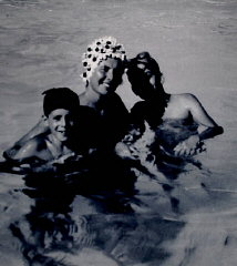 Regina with sons Harry and Paul in a swimming pool....