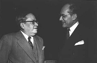 Raphael Lemkin (right) with Ambassador Amado of Brazil (left) before a plenary session of the General Assembly at which the Convention on the Prevention and Punishment of Genocide was approved. Palais de Chaillot, Paris, December 11, 1948.