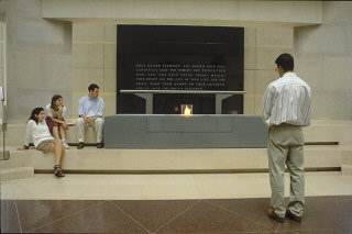 Visitors view the eternal flame in the Hall of Remembrance at the United States Holocaust Memorial Museum.