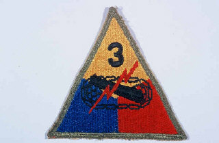 "Insignia of the 3rd Armored Division. ""Spearhead"" was adopted as the nickname of the 3rd Armored Division in recognition of the division's role as the ""spearhead"" of many attacks during the liberation of France in 1944."