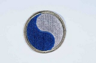 "Insignia of the 29th Infantry Division. ""Blue and Gray"" was coined as the nickname of the 29th Infantry Division by the division's commander during World War I. The name commemorates the lineage of the mid-Atlantic states' National Guard units that formed the division, many with service on both sides during the Civil War."