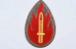 "Insignia of the 63rd Infantry Division. The 63rd Infantry Division was nicknamed the ""Blood and Fire"" division soon after its formation in the spring of 1943. The nickname commemorates British prime minister Winston Churchill's statement at the Casablanca Conference in January 1943 that ""the enemy would bleed and burn in expiation of their crimes against humanity."" The divisional insignia illustrates the nickname."