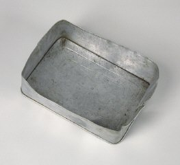 Aluminum food container lid used by a Hungarian Jewish...