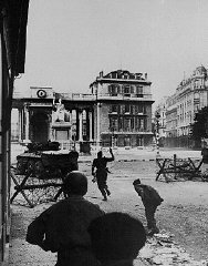 Men of the 2nd French Armored Division attack the Chamber of Deputies, one of the last German stongholds, during the battle to l