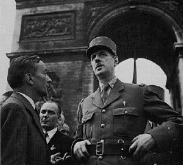 French General Charles de Gaulle and resistance leader Georges Bidault confer before marching down the Champs-Elysees to Notre D