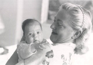Norman's daughter, Esther, at three weeks of age, with...