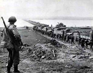 German prisoners file across the Rhine as American...