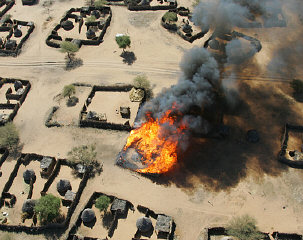 Beginning of the burning of the village of Um Zeifa in Darfur after the Janjaweed looted and attacked.