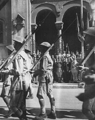 Allied troops march in Tunis following Allied success...