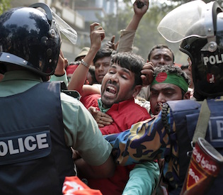 Protesters try to break through a police barricade during a demonstration against a strike called by the opposition in Dhaka, Bangladesh, Monday, Feb. 9, 2015.