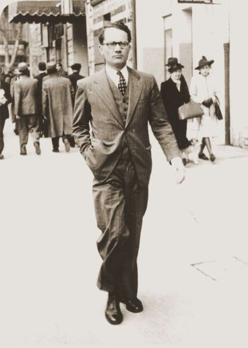 Varian Fry walking along the street in Marseilles. France, 1940-1941.