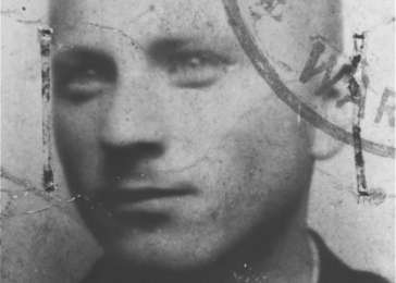 False identification card photo of Benjamin (Miedzyrzecki) Meed as a member of the Warsaw ghetto underground. Warsaw, Poland, 1943. <i>US Holocaust Memorial Museum, courtesy of Benjamin (Miedzyrzecki) Meed</i>
