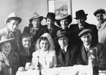 Group portrait of family and friends at the wedding of Regina and Sam Spiegel at the Foehrenwald displaced persons camp.
