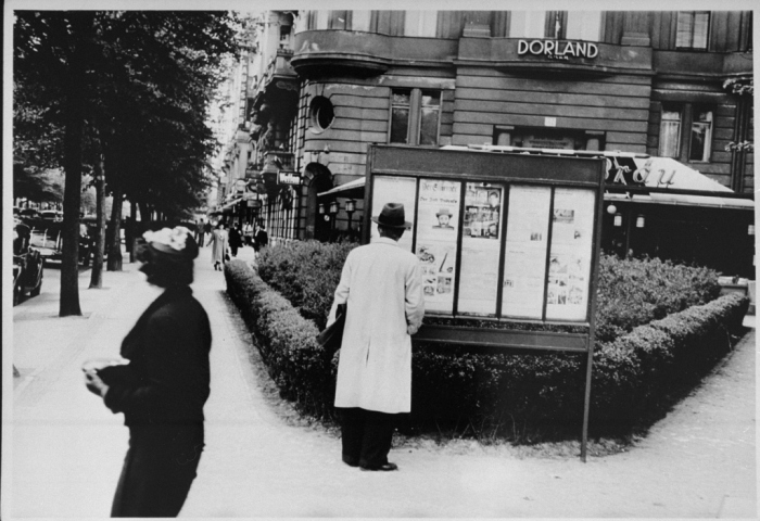 A pedestrian stops to read an issue of the antisemitic newspaper <i>Der Stuermer</i> (The Attacker) in a Berlin display box. <i>Der Stuermer</i>  was advertised in showcase displays near bus stops, busy streets, parks, and factory canteens throughout Germany. <i>Der Stuermer</i> served as a mouthpiece for Nazi ideology and its editor was a close associate of Hitler. Berlin, Germany, probably 1930s.