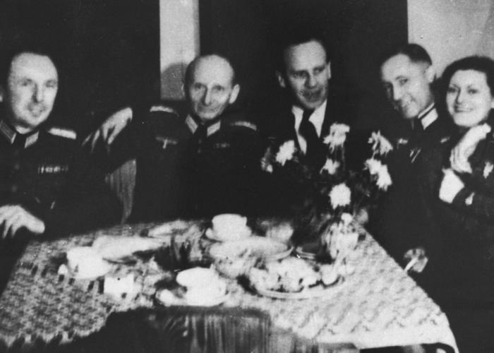 Oskar Schindler (third from left) at a party with local SS officials on his 34th birthday. Schindler attempted to use his connections with German officials to obtain information that might protect his Jewish employees.
