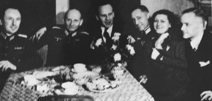 Oskar Schindler (center) at a dinner party in Krakow