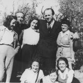 Oskar Schindler (second from the right) poses with a group of Jews he rescued one year after the war (1946).