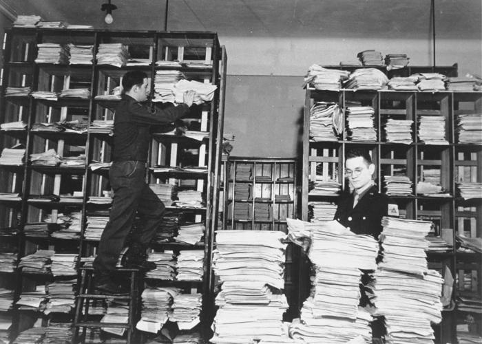 US Army staffers organizing stacks of German documents