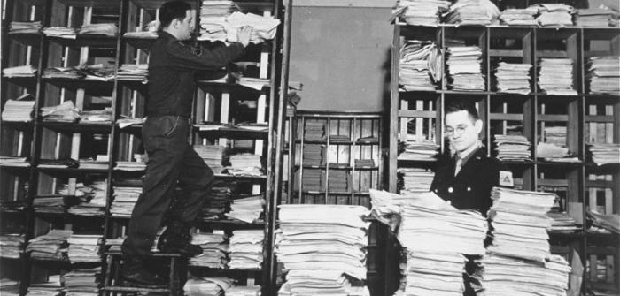 US Army staffers organize stacks of German documents collected by war crimes investigators as evidence for the International Military Tribunal. Nuremberg, Germany, between November 20, 1945, and October 1, 1946.