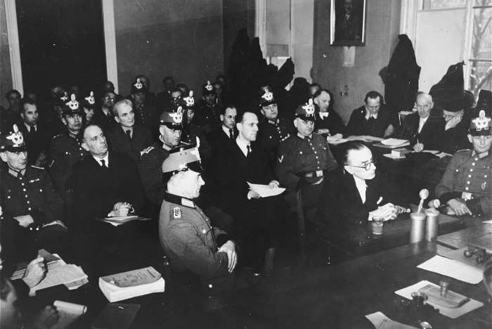 "Participants in the July 1944 plot to assassinate Hitler and members of the ""Kreisau Circle"" resistance group on trial before the People's Court. Pictured are Dr. Franz Reisert, Dr. Theodor Haubach, Graf von Moltke, Theodor Steltzer, and Dr. Eugen Gerstenmeier."