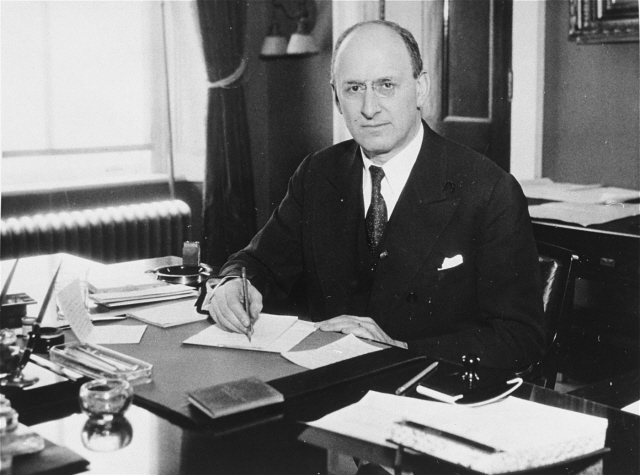 Portrait of Henry Morgenthau Jr. at his desk in the US Department of the Treasury. Inspired by his father's actions during the Armenian genocide, Morgenthau Jr. was a key advocate for the 1944 establishment of the War Refugee Board which rescued as many as 200,000 Jews from Nazi Europe. Washington, DC, 1941–44.