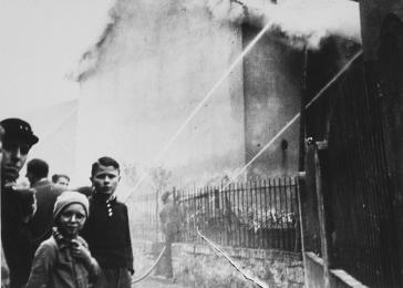 The burning of a synagogue during Kristallnacht. The local fire-department prevented the fire from spreading to a nearby home, but made no attempt to intervene in the synagogue fire. Ober Ramstadt, Germany.