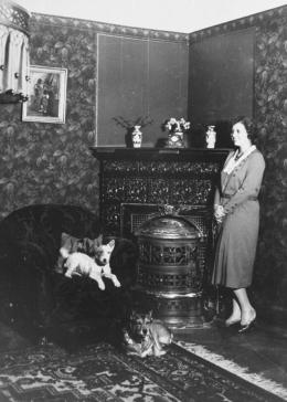Olga Fuchel relaxes with her dogs in the Vienna apartment she shared with her husband, Rudolf.