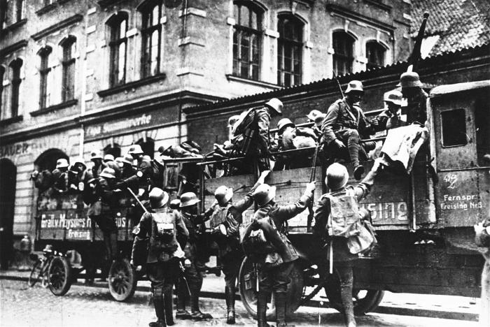 Men supporting Adolf Hitler mobilize during the Beer Hall Putsch.
