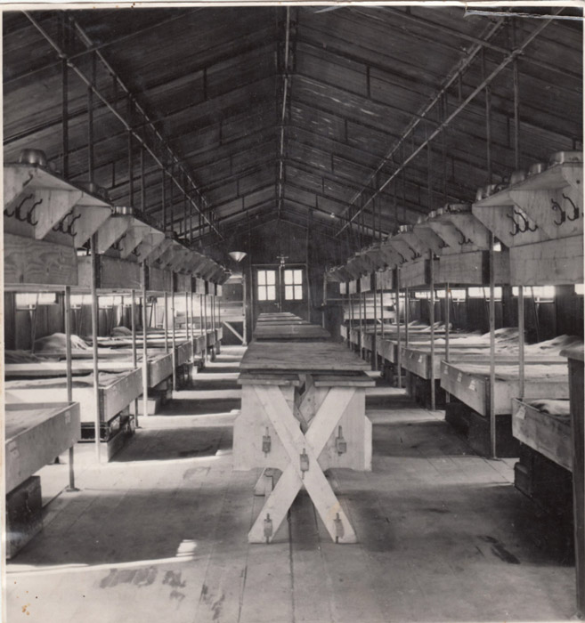 The barracks in a forced labor camp in Hajdúhadház, Hungary. Just prior to the mass deportation of Hungary's Jews, the Hungarian ministry of defense mobilized several thousand Jewish men for labor service. March 1944–October 1944.