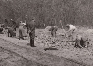 Members of a Jewish forced labor battalion work at a construction site building a railroad spur. Hajdúhadház, Hungary, March 1944–October 1944.
