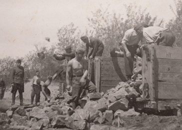 Members of a Jewish forced labor battalion toil at a construction site. Hajdúhadház, Hungary, March–October 1944.