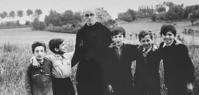 Father Bruno poses with five Jewish children he is sheltering, 1942-1944.