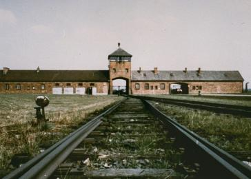 View of the entrance to Auschwitz-Birkenau; taken from inside the camp.