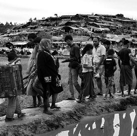 Rohingya walk into a section of Balukhali refugee camp in Bangladesh, September 2017.