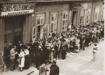 Jews hoping to receive exit visas at a police station in Vienna.