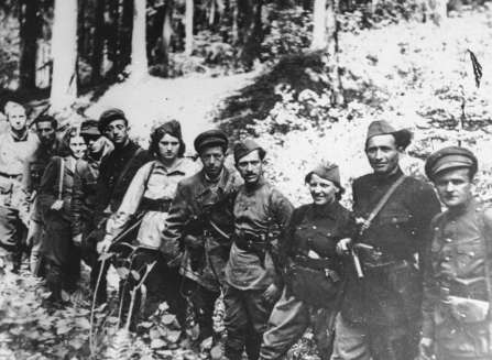 Jewish partisans, who were part of the Kovno ghetto resistance, are pictured in the Rudninkai forest near Vilna, just after the liberation.
