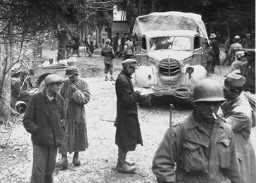 Survivors and American troops in Gunskirchen, a subcamp of the Mauthausen concentration camp, after liberation. Gunskirchen, Austria, May 6–15, 1945.