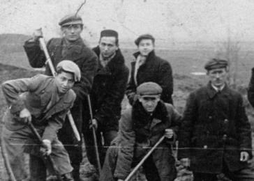 Jewish men from the Kozienice ghetto drain a swamp in the nearby village of Wolka. Standing in the middle back is David Bayer.