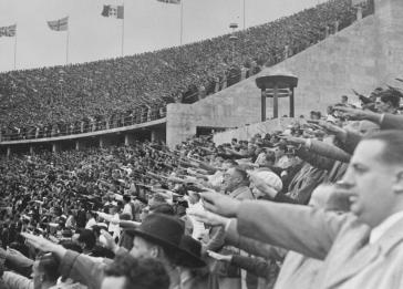 German citizens salute Adolf Hitler at the opening of the 11th Olympiad in Berlin.