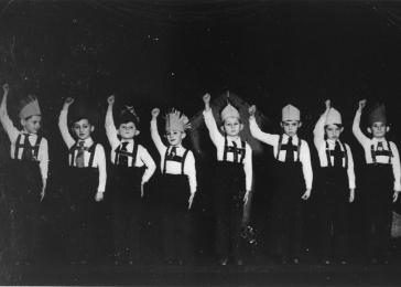 First grade students put on a play about American Indians at the Jewish Boys' Orphanage School of Budapest (Zsido Fiu Arvahaz), a Jewish primary school attended by both orphaned and non-orphaned children. George Pick is fourth from the right.