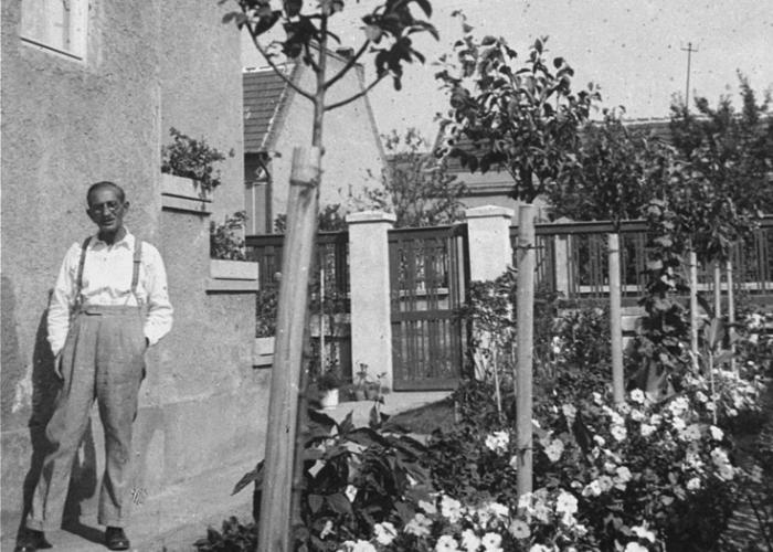 Jeno Pick, the grandfather of Gyorgy Pick, poses beside his home located at Dorozsmai Street 26, Budapest XIV.