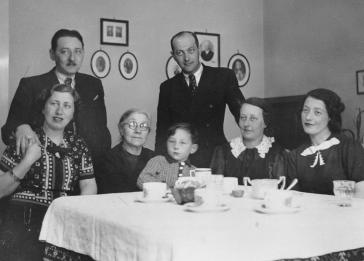 Members of the extended Kornhauser family sit around a dining room table.