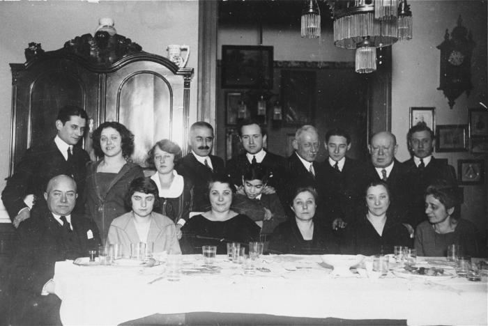 Group portrait of the extended Spitzer family in their dining room.